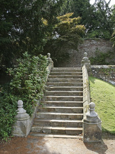 Stone steps: A stone staircase in a garden in East Sussex, England.