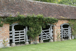 Old stables: Old gated stables in the grounds of a stately house in Somerset, England.
