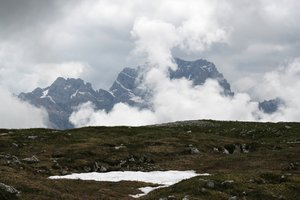 Misty mountains 2: Mountains and a plateau in early summer in the Dolomites, Italy.