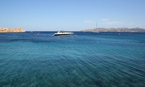 Clear blue harbour: A clear blue seawater harbour in the Maddalena Islands, Sardinia.