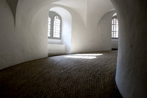 Passageway and windows: Sunlit windows in an old tower in Copenhagen, Denmark.