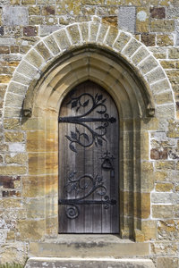 Ornate church door: An ornate door to a church in Sussex, England.