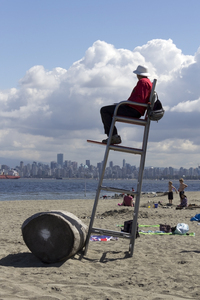 Lifeguard: A lifeguard on the beach at Vancouver, Canada.
