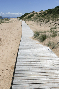 Beach boardwalk: A boardwalk over a soft sand beach in southern Spain.
