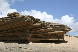 Eroded rock: An eroded boulder of sedimentary rock on a beach in southern Spain.