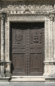 Ancient carved door: An ancient ornate carved door in Seville, Spain.