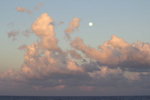 Full moon at dawn: The full moon and clouds at dawn over the Mediterranean.