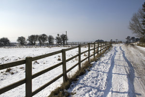 Farm fences in snow: Farm fences in February snow on the South Downs, West Sussex, England.