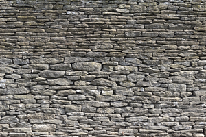 Drystone wall texture: A drystone wall in a village in the Cotswolds, England.