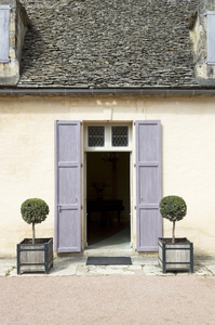 Doorway with shutters: A doorway with shutters in a chateau in France.