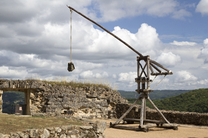 Mediaeval catapult: A replica of a small XII Century catapult, called a perrière or bricole, at Castelnaud-la-Chapelle, Dordogne, France. Photography in the grounds of this castle was freely permitted.