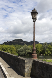 Streetlamp on a bridge: An old streetlamp on a bridge in France.