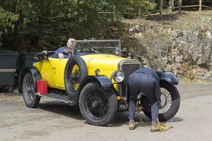 Car breakdown: Drivers of a vintage car experiencing a breakdown whilst touring in France.