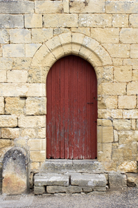 Ancient door: A door in an old house in the Dordogne, France.
