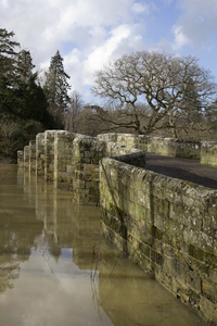Old bridge in floodwater: An old stone bridge in West Sussex, England, with winter floodwater.