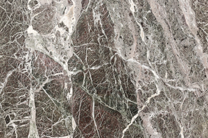 Marble texture: Polished marble on a plinth in a public square in Italy.