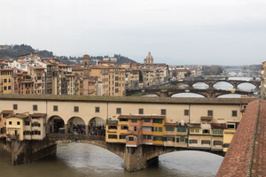 Old covered bridge: An old covered bridge, and other bridges, in Florence, Italy.