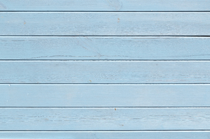 Blue wood texture: Blue wooden panelling on a house in England.