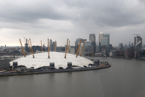 London city: View through a cable car window of London, England, showing the River Thames, O2 arena, Canary Wharf, etc.