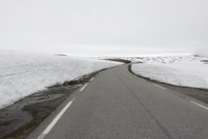 Snow banks: Snow banked up at the sides of a road on a high plateau in Norway.