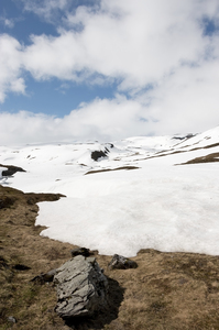 Retreating snow: Snow melting at the onset of milder weather in July on a high plateau in Norway.