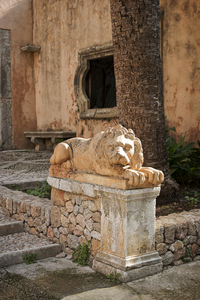 Old stone lion: An old statue of a lion in a Moorish garden courtyard in Majorca, Balearic Islands, Spain.