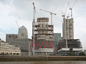 Skyscraper construction: Skyscrapers under construction at Canary Wharf, London, England.