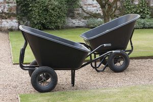 Wheelbarrows: Wheelbarrows in a walled garden in England.