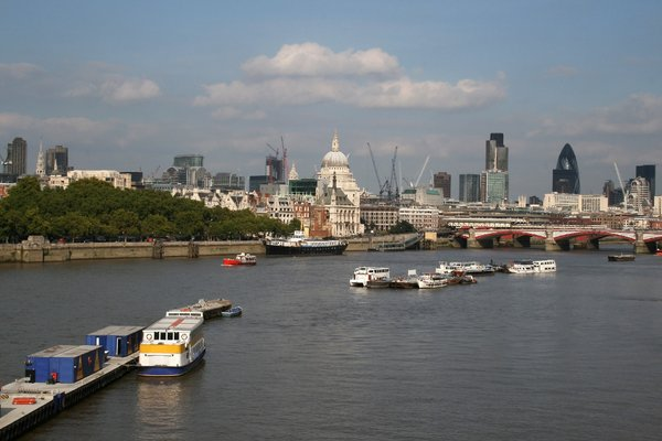 River Thames, London: A view from the south bank of the River Thames as it passes through central London, England. St Paul's cathedral and other landmarks are visible.