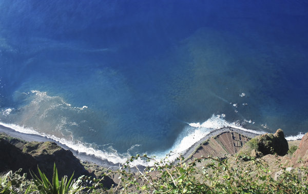 A very long drop!: Looking down at the Atlantic Ocean from a cliff more than 600m high on the southern coast of Madeira.