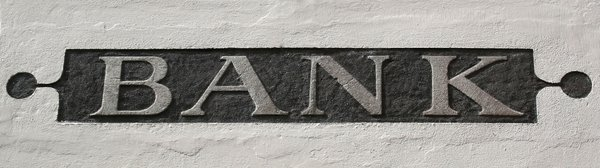 Bank sign: An old bank sign on a wall in Austria.