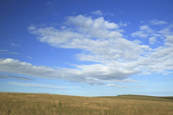 Downland sky: Summer evening cloud formations on the South Downs, East Sussex, England.