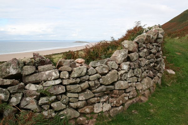 Coastal wall: An old dry stone wall by Rhossili Bay, Wales, UK.