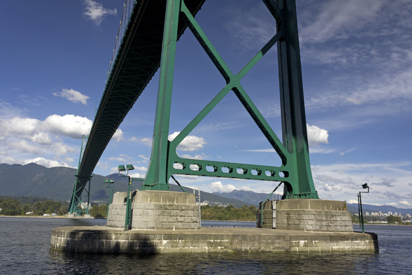 Suspension bridge: View from underneath of Lions Gate suspension bridge across the Burrard Inlet, Vancouver, Canada.