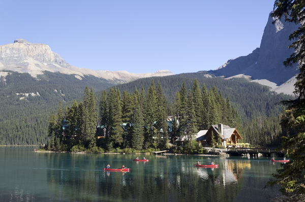 Canoes heading home: Canoes headimg for home on a lake in the Rockies, Canada.