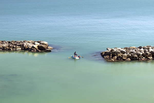 Fisherman: A fisherman in southern Italy, rowing to drop his nets into position.