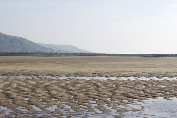Mudflats: Sandy mudflats exposed at Low tide at Barmouth, Wales.