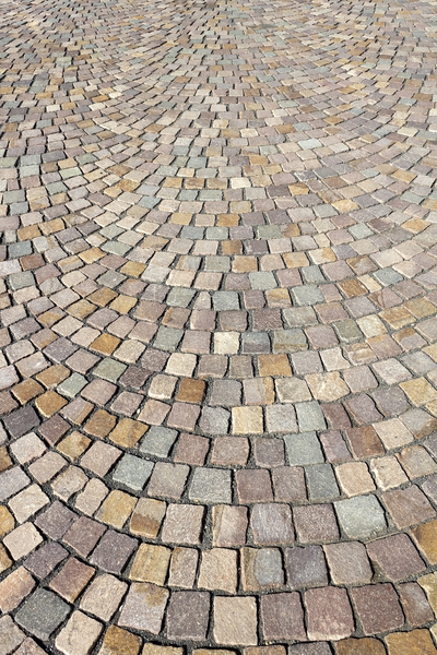 Block paving texture: Block paving arranged in a pattern in a pedestrianized area in Israel.