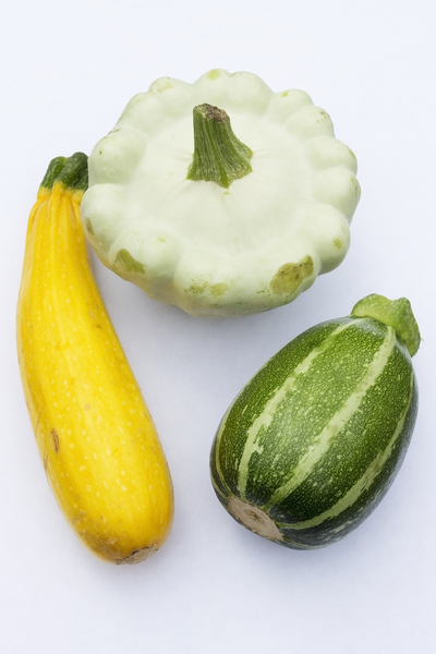 Courgettes: Courgettes of diverse shapes.