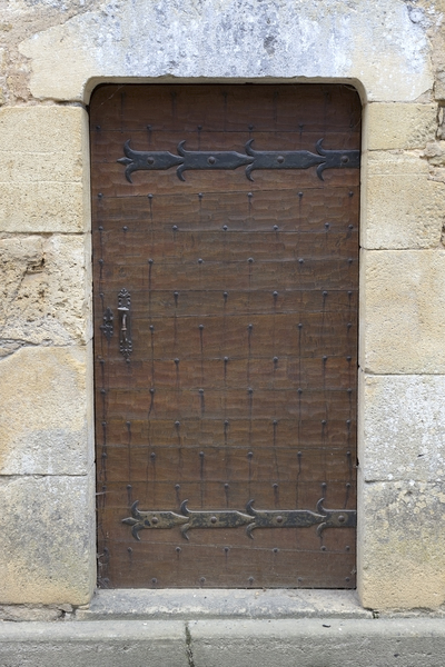 Ancient door: One of two iron-studded wooden doors in an old house in a village in the Dordogne, France.