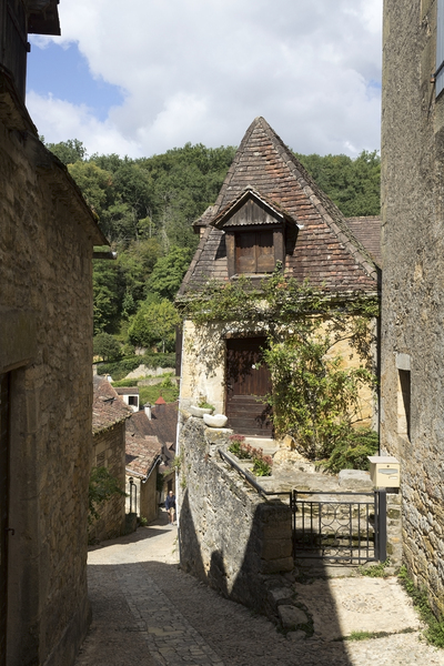 Steep alley: An alley in an old hillside village in the Dordogne, France.