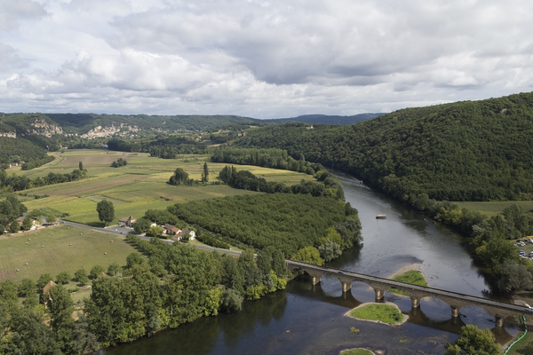 Landscape with bridge: A river valley and bridge in the Dordogne, France.