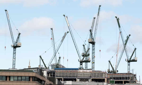 Cranes: Cranes on a building site in London, England.