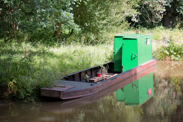 Canal boat store: A workman's floating store on a canal in West Sussex, England.