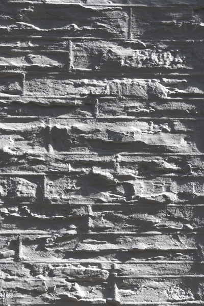 Wall texture: Painted rough wall photographed in oblique light.