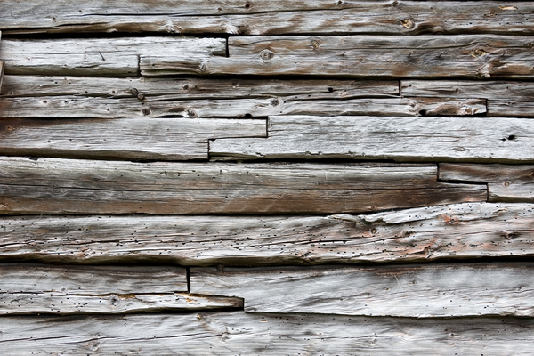 Wooden wall texture: Part of a wall of an old wooden cabin in Norway