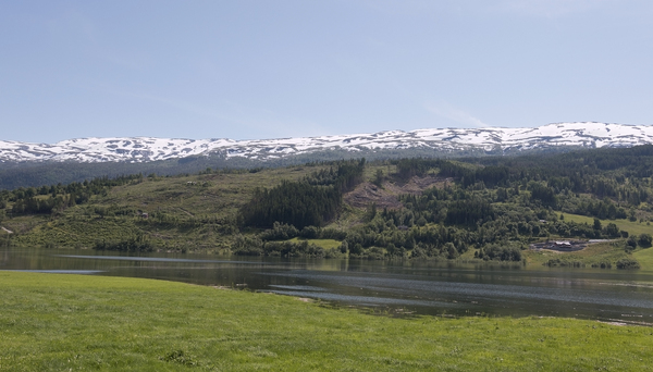 Norway landscape: Mountains, hills water and meadows in Norway.