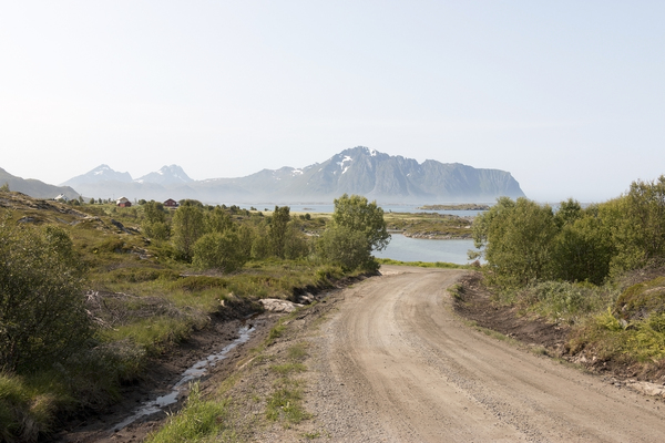 Lane to the coast: A rural lane to the coast of the Lofoten Islands, Norway.