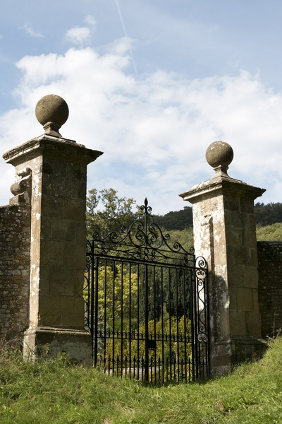 Garden gate: Gated entrance to the garden of an old country house in Surrey, England.