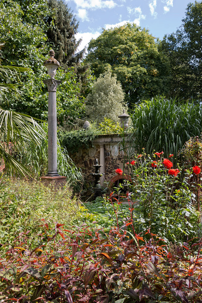 Italian garden: A garden in Italian style with ornamental pillar in Kent, England.